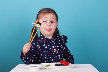 Aluminium Prints Sushi bar little girl eating sushi chopsticks
