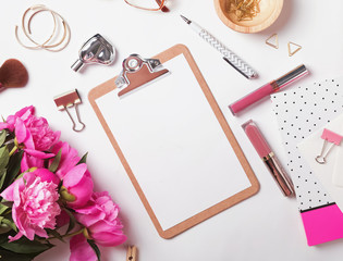 Clipboard mock-up on the  feminine workplace with peonies and stationary
