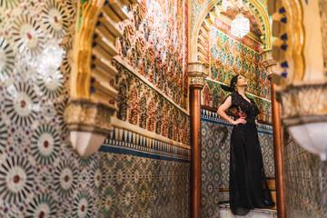 Charming woman in dress in corridor