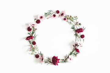 Flowers composition. Wreath made of eucalyptus leaves and pink flowers on white background. Flat lay, top view, copy space