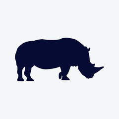 Vector silhouette of a rhinoceros on a white background.
