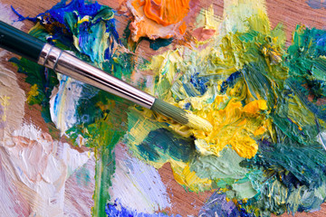 Vibrant multi-coloured artists oil or acrylic paints palette and paintbrush