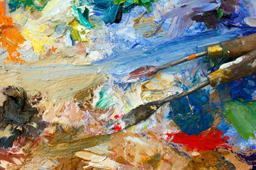 Vibrant multi-coloured artists oil or acrylic paints palette semi abstract close-up with palette knives