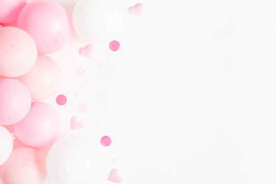 Balloons on white background. Frame made of white and pink balloons. Birthday, valentines day, holiday concept. Flat lay, top view, copy space