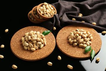 Tasty pistachio nuts on table