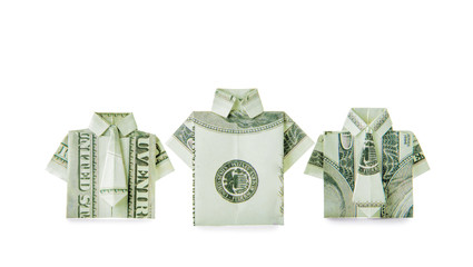 Origami shirts made of dollar banknotes on white background