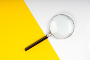 Magnifier glass on the yellow background