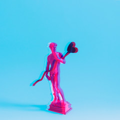 Creative concept of neon David is a masterpiece of Renaissance sculpture created  by Michelangelo. Vaporwave style with double exposure. Heart for Valentine's day