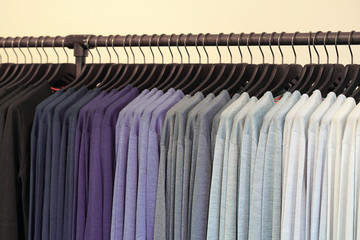 clothes hanger with t shirt. Fashionable clothing on hangers in shop. sport of T Shirts are hanging on Clothes Hanger , Colorful T Shirt