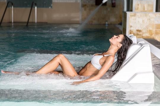 Beautiful woman lying and making spa