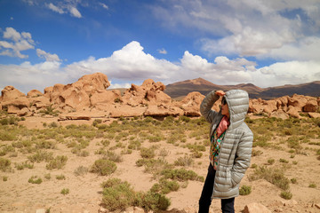 One Female Tourist Looking at the Amazing Landscape with Plenty of Rock Formations in Siloli Desert, High Altitude Expanse of Potosi Department, Bolivia