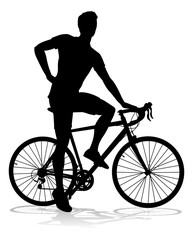A bicycle riding bike cyclist in silhouette