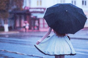 Raining weather. Autumn rain. Unhappy girl in stress in dress hold umbrella. Raining in city. Umbrella against street. Wet woman with illness was caught in rain. Girl in stress from illness