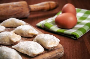 raw delicious ukrainian varenyky and eggs