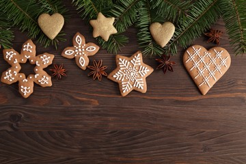 Homemade gingerbread cookies on a dark background. Sweet food.