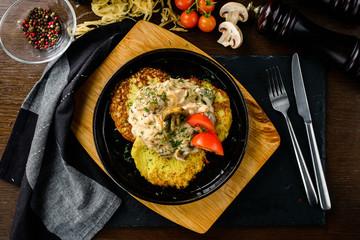 homemade potato pancakes, Vegetable fritters. Latkes in frying pan