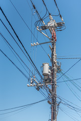Electricity pole with transformer in Japan.