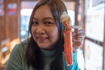 Woman hands holding king crab with surprised face, Hakodate Morning Market, Japan.