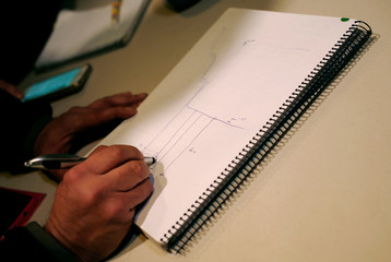 Angel Garcia, delegate of Malaga's Civil Engineers, draws in a paper during a news conference showing the area where Julen fell into a deep well eight days ago when the family was taking a stroll through a private estate, in Totalan