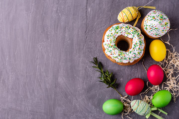 Easter, cake, eggs, holiday. Easter cake and colorful eggs on a dark background. It can be used as a background