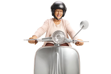 Cheerful senior woman with a helmet riding a vintage scooter