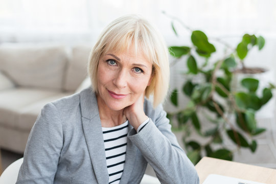 Portrait of mature businesswoman looking at camera