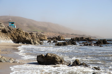 Beach in California with dust coming from the mountains caused by so called Santa Ana winds.