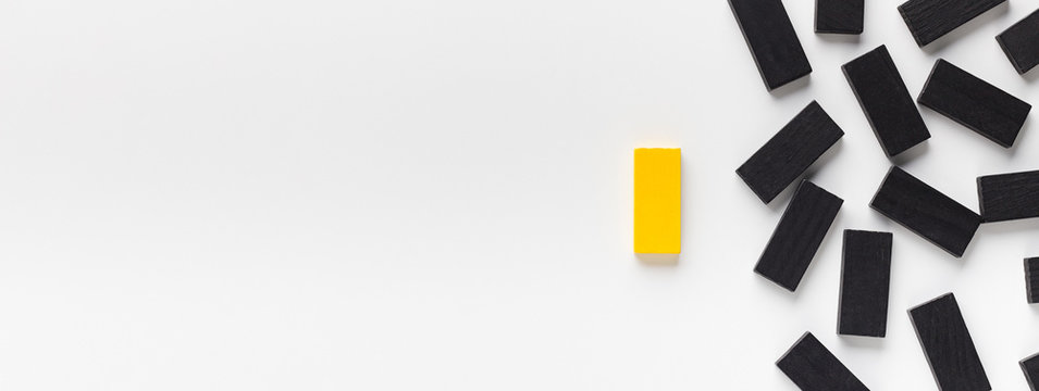 Yellow block standing out of black ones