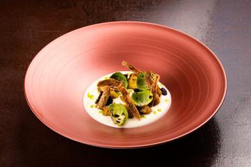 Corn dumplings on cauliflower puree, Brussel sprouts, crunchy potato skins,