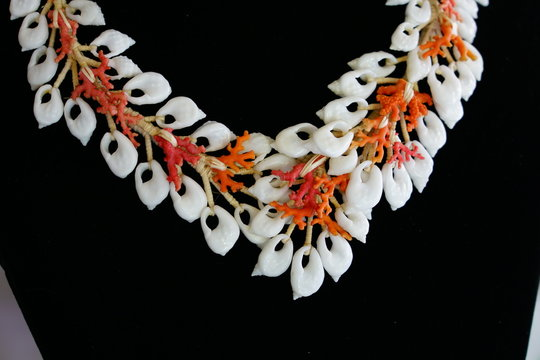 Traditional craft jewelry made with colorful shells from the Tuamoto and Gambier islands in French Polynesia