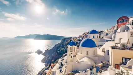 Wall Mural - Architecture of Oia village, Santorini island in Greece, on a sunny day with dramatic sky. 4K timelapse.