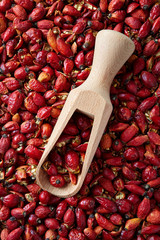 Wooden scoop with dried organic rose hip