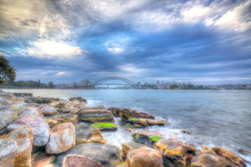 SYDNEY, AUSTRALIA - SEPTEMBER 08, 2016: HDR view of water wave and opera house background. Blurred image - painting concept.