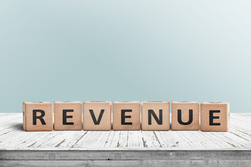 Revenue sign on a wooden desk