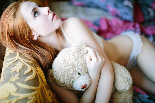 Sexy redhead girl posing at home studio