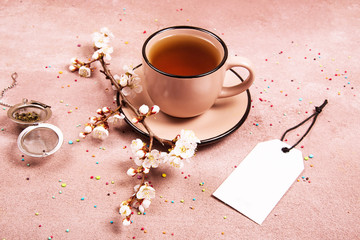 A cup of tea in the spring decoration. View from above. Place for text.