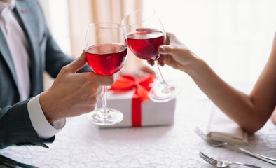Valentine's Day concept. Happy couple in love with. A young loving couple celebrating Valentine's Day in the restaurant. Lovers give each other gifts. Romance restaurant for Valentine's Day- concept.