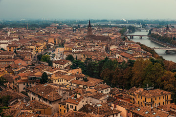 Aerial view of Verona rooftops and Adige river glimpse, Italy