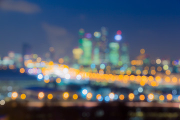 Poster Amusementspark Defocused abstract image. Bokeh effect. Golden lights of the big city. Night city landscape, lights and Windows of houses.