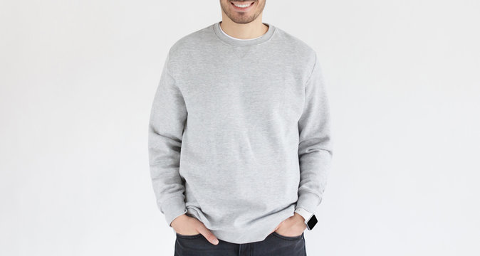 Horizontal banner of young man in gray sweatshirt, standing isolated on background. No face photo
