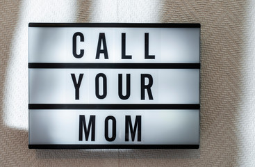 Message Call Your Mom on illuminated board. Mothers day concept with text.