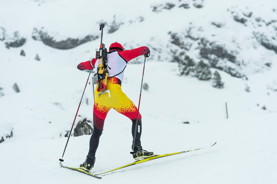 Winter sports. A participant in a biathlon competition, in a winter season in Spain, in a snowy landscape.
