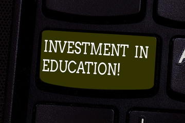 Text sign showing Investment In Education. Conceptual photo Attain knowledge which will increase earning Keyboard key Intention to create computer message pressing keypad idea