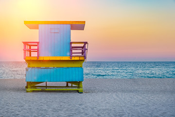 Wall Mural - Famous lifeguard tower at South Beach in Miami at sunset