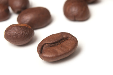 closeup of coffee beans on white background