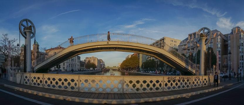 Paris, France - 11 03 2018: Canal Lourcq. The lift bridge of Flanders at sunset