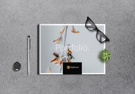 Portfolio Brochure Layout with Orange Accents