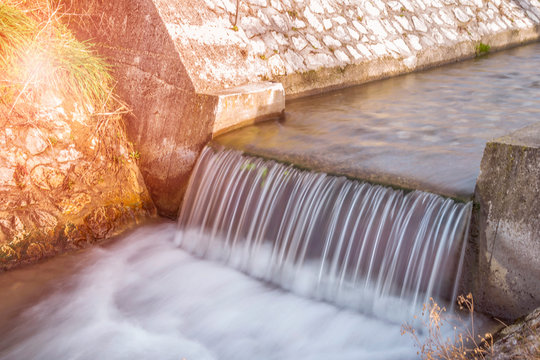 A small weir on a creek. Long exposure