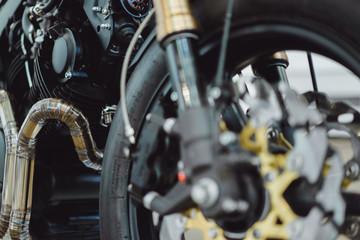 details of custom motorcycle, headlight, gasoline tank, wheel, metal.