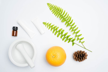 scrubs with natural ingredients leaves on white